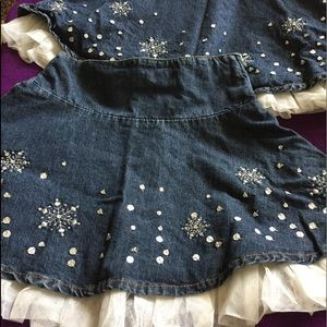 2Gymboree denim skirts.With ruffles-side zipper.